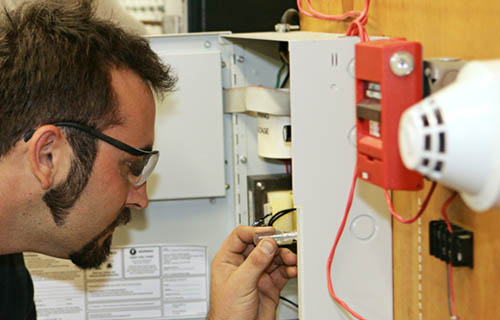 Man inspecting a fire system