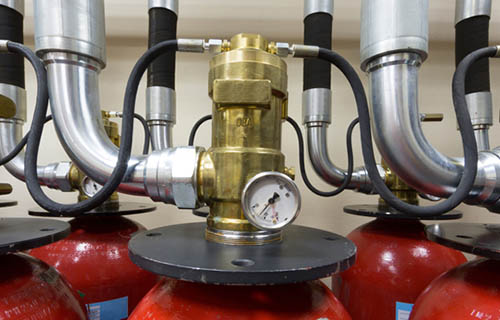 FIRE SUPPRESSION SYSTEMS with gages ontop of cylinders